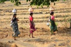 women carrying water